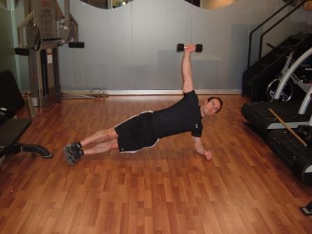 side plank dumbbell raise