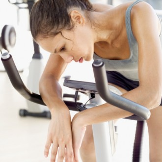 tired-woman-exercise-bike