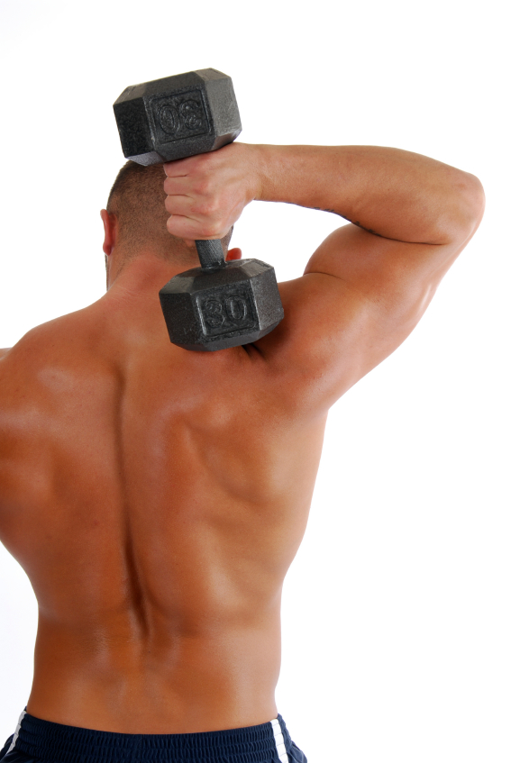 A bodybuilder lifting a dumbell over his shoulders