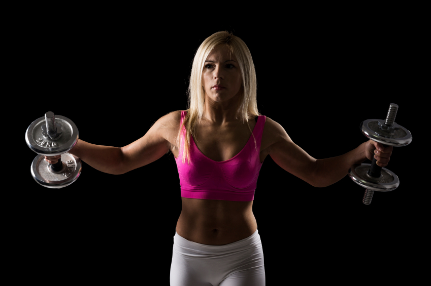 Good looking athletic built woman working out in a gym