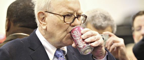 Warren Buffett, chief executive officer of Berkshire Hathaway, drinks a Cherry Coca-Cola as he tours the exhibition floor prior to the Berkshire Hathaway annual meeting in Omaha, Nebraska, U.S., on Saturday, May 1, 2010. Buffett, the Wall Street critic who invested $5 billion in Goldman Sachs Group Inc., said he supports the bank's Chief Executive Officer Lloyd Blankfein '100 percent' after the firm was sued by regulators for fraud. Photographer: Daniel Acker/Bloomberg via Getty Images