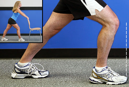 webmd_photo_of_trainer_doing_calf_stretch