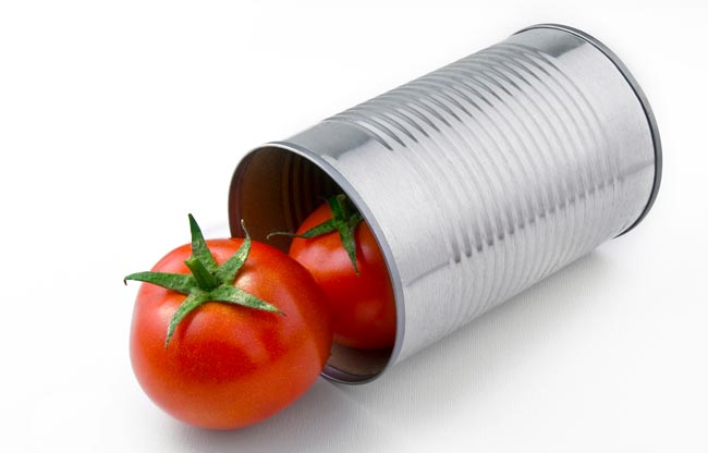 Two-natural-tomatoes-popping-o-25639721