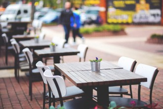 kaboompics.com_Street view of a coffee terrace with tables and chairs