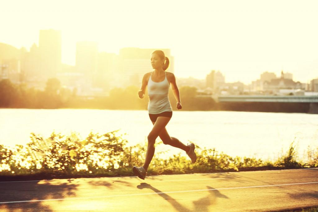 Female runner running at sunset