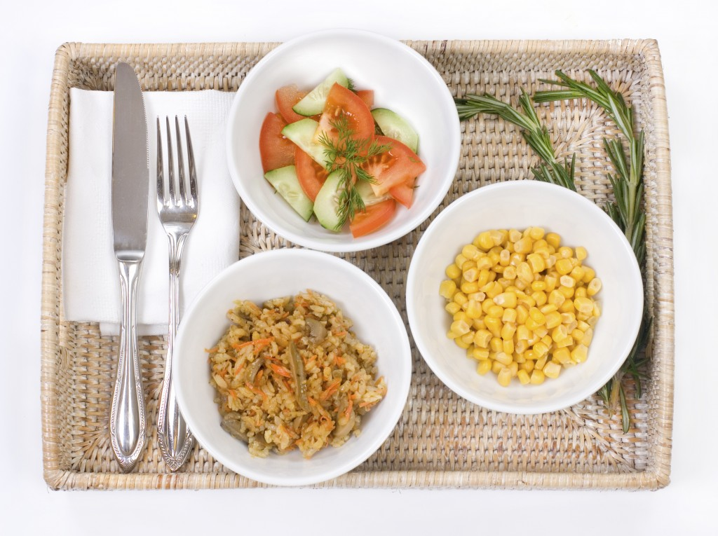Three bowls with vegetarian dishes
