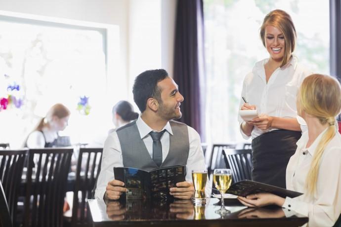 Business people ordering dinner