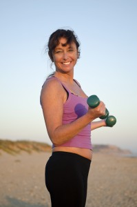 woman exercising on the beach.