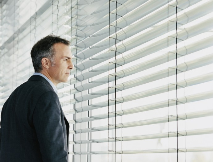 Businessman Looking at the View Out of a Window