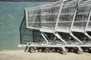 Close-up of shopping carts in a row