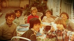 Celebrating a birthday with friends as a child in France.