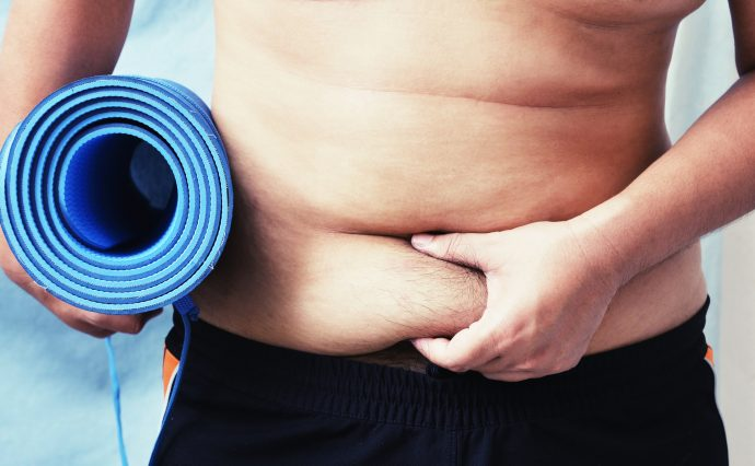 fat man exercise with yoga mat